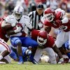 Tulsa\'s Trey Watts (22) is brought down after a run during a college football game between the University of Oklahoma Sooners (OU) and the Tulsa Golden Hurricane (TU) at Gaylord Family-Oklahoma Memorial Stadium in Norman, Okla., on Saturday, Sept. 14, 2013. Photo by Steve Sisney, The Oklahoman