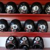 East Central University batting helmets, all with a memorial ribbon for slain Australian player Chris Lane, are pictured before a memorial game against Redlands Community College in Duncan, Okla, Thursday, Oct. 24, 2013. (AP Photo/Sue Ogrocki)
