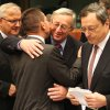 """Photo -   Luxembourg's Prime Minister and chairman of the Eurogroup Jean-Claude Juncker, second right, greets Greek Finance Minister Yannis Stournaras, second left, as European Commissioner for Economic and Monetary Affairs Olli Rehn, left, and President of the European Central Bank Mario Draghi, right, look on, during the Eurogroup finance ministers meeting in Brussels, Monday, Nov, 12, 2012. Greece's international lenders have prepared a """"positive"""" report on the country's reform efforts, a crucial step in its efforts to secure the next installment of its bailout loan, the head the of group of finance ministers from the 17 euro countries said Monday. (AP Photo/Yves Logghe)"""