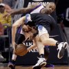 Minnesota Timberwolves\' Andrei Kirilenko, bottom, of Russia, falls into Phoenix Suns\' P.J. Tucker (17) during the first half of an NBA basketball game, Tuesday, Feb. 26, 2013, in Phoenix. (AP Photo/The Arizona Republic, Michael Chow) MARICOPA COUNTY OUT; MAGS OUT; NO SALES