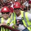 Bill Kauffman, Tulsa, and son Joey, 6, wear Bell Dozer apparel, during a college football game between the University of Oklahoma Sooners (OU) and the Tulsa Golden Hurricane (TU) at Gaylord Family-Oklahoma Memorial Stadium in Norman, Okla., on Saturday, Sept. 14, 2013. Photo by Steve Sisney, The Oklahoman
