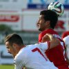 Photo - Iran's Masoud Shojaei, right, with Marko Vesovic, left, of Montenegro during a friendly soccer match between Iran and Montenegro, in Hartberg, Austria, Monday, May 26, 2014. (AP Photo/Ronald Zak)