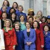 Photo - House Minority Leader Nancy Pelosi of Calif., front row, center, poses with other female House members on the steps of the House on Capitol Hill in Washington, Thursday, Jan. 3, 2013, prior to the official opening of the 113th Congress . (AP Photo/Cliff Owen)
