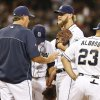 Photo - San Diego Padres pitching coach Darren Balsley, second from left, talks with starter Andrew Cashner after Cashner loaded the bases with a walk and just before before he surrendered a two-run single to the Arizona Diamondbacks during the third inning of a baseball game on Friday, May 2, 2014, in San Diego.  (AP Photo/Lenny Ignelzi)
