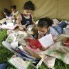 Vladia Cortest, Jazlynn Gordon, Cyane Sullivan, and Destinee Neloms (left to right), first-graders at Eisenhower Elementary School read in a tent at Camp Read-A-Lot in Norman, Oklahoma on Tuesday, May 15, 2007. BY STEVE SISNEY, THE OKLAHOMAN