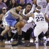 Denver Nuggets forward Wilson Chandler, left, battles Sacramento Kings\' Ben McLemore, center, and Isaiah Thomas, for the ball during the third quarter of an NBA basketball game in Sacramento, Calif., Sunday, Jan. 26, 2014. The Nuggets won 125-117.(AP Photo/Rich Pedroncelli)