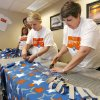 Karin VanAuken (left) and Cathy Luther work on blankets as they and other McKesson employees prepare care packages for veterans as part of McKesson Corporation\'s 10th Annual Community Days volunteer program at the facility in Oklahoma City, OK, Thursday, April 23, 2009. BY PAUL HELLSTERN, THE OKLAHOMAN