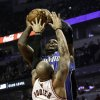 Chicago Bulls\' Carlos Boozer (5) tries to block a shot by Orlando Magic\'s Glen Davis during an NBA basketball game in Chicago on Tuesday, Nov. 6, 2012. (AP Photo/Charles Cherney)