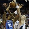 Photo - Oklahoma City Thunder center Etan Thomas (36) goes up for a shot against Orlando Magic center Marcin Gortat, of Poland, during the first half of an NBA basketball game in Orlando, Fla., Wednesday, Nov. 18, 2009. (AP Photo/John Raoux) ORG XMIT: DOA102
