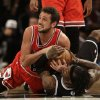 Chicago Bulls\' Marco Belinelli, top, and Brooklyn Nets\' Gerald Wallace fight for a loose ball during the second half of Game 1 in the first round of the NBA basketball playoffs at the Barclays Center, Saturday, April 20, 2013, in New York. The Nets defeated the Bulls 106-89. (AP Photo/Seth Wenig)