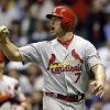 Photo - St. Louis Cardinals' Matt Holliday reacts after scoring on David Freese' two-run single against the Milwaukee Brewers during the eighth inning of a baseball game Saturday, Sept. 21, 2013, in Milwaukee. (AP Photo/Jeffrey Phelps)