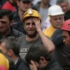 A miner cries as rescue workers carry the dead body of a miner from the mine in Soma, western Turkey, Wednesday, May 14, 2014. An explosion and fire at the coal mine killed at least 232 workers, authorities said, in one of the worst mining disasters in Turkish history. Turkey\'s Energy Minister Taner Yildiz said 787 people were inside the coal mine at the time of the accident. (AP Photo/Emrah Gurel)