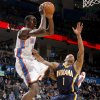 Oklahoma City\'s Serge Ibaka (9) passes the ball beside Indiana\'s Dahntay Jones (1) during the NBA basketball game between the Oklahoma City Thunder and the Indiana Pacers at the Oklahoma City Arena, Wednesday, March 2, 2011. Photo by Bryan Terry, The Oklahoman