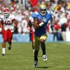 UCLA wide receiver Shaquelle Evans, right, races for a 64-yard touchdown run after a catch, as Utah defensive end Jacoby Hale, left, pursues during the first half of their NCAA college football game, Saturday, Oct. 13, 2012, in Pasadena, Calif. (AP Photo/Alex Gallardo)