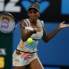 Venus Williams of the US makes a forehand return to Russia\'s Maria Sharapova during their third round match at the Australian Open tennis championship in Melbourne, Australia, Friday, Jan. 18, 2013. (AP Photo/Dita Alangkara)