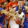 OSU\'s James Anderson (23) passes the ball away from Xavier Henry (1), left, and Cole Aldrich (45) of KU in the second half during the men\'s college basketball game between the University of Kansas (KU) and Oklahoma State University (OSU) at Gallagher-Iba Arena in Stillwater, Okla., Saturday, Feb. 27, 2010. OSU won, 85-77. Photo by Nate Billings, The Oklahoman
