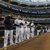 New York Yankees starting pitchers bow their heads during a moment of silence before a baseball game at Yankee Stadium in New York, Tuesday, April 16, 2013. From left, Joba Chamberlain, Hiroki Kuroda, Phil Hughes, CC Sabathia, Andy Pettitte (AP Photo/Kathy Willens)