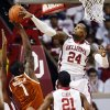 Oklahoma\'s Romero Osby (24) blocks a shot by Texas\' Sheldon McClellan (1) as Oklahoma\'s Cameron Clark (21) watches during their NCAA college basketball game, Monday, Jan. 21, 2013, in Norman, Okla. (AP Photo/The Oklahoman, Nate Billings) LOCAL TV OUT (KFOR, KOCO, KWTV, KOKH, KAUT OUT); LOCAL INTERNET OUT; LOCAL PRINT OUT (EDMOND SUN OUT, OKLAHOMA GAZETTE OUT) TABLOIDS OUT