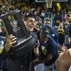 Michigan forward Mitch McGary holds the Big Ten Conference Basketball Champions trophy in celebration with teammates on the court after an NCAA college basketball game against Indiana at Crisler Center in Ann Arbor, Mich., Saturday, March 8, 2014. Michigan won 84-80, and celebrated their outright Big Ten regular season championship. (AP Photo/Tony Ding)