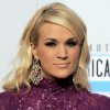"""FILE - In this Sunday, Nov. 18, 2012 file photo, Carrie Underwood arrives at the 40th Anniversary American Music Awards in Los Angeles. Underwood will star in NBC\'s live broadcast of """"The Sound of Music"""" late next year, according to a news release Friday, Nov. 30, 2012. (Photo by Jordan Strauss/Invision/AP, File)"""