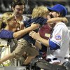 New York Mets\' pitcher R.A. Dickey is greeted by his wife, Anne, and son, Eli, 3, after the Mets\' 5-0 victory over the Detroit Tigers in a baseball game Wednesday, June 23, 2010, in New York. Dickey pitched eight innings. (AP Photo/Kathy Kmonicek)