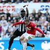 Manchester United\'s Wayne Rooney, right, vies for the ball with Newcastle United\'s Cheick Tiote, left,during their English Premier League soccer match at the Sports Direct Arena, Newcastle, England, Sunday, Oct. 7, 2012. (AP Photo/Scott Heppell)