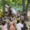 Photo - Randy Decker, director of community relations for SandRidge Energy, plays with children in Frettas, Haiti, in November. It was Decker's second volunteer trip to the impoverished island nation. <strong> - Provided</strong>