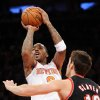 New York Knicks\' J.R. Smith shoots over Portland Trail Blazers\' Victor Claver (18), of Spain, during the second quarter of an NBA basketball game, Tuesday, Jan. 1, 2013, at Madison Square Garden in New York. (AP Photo/Bill Kostroun)