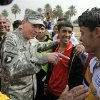 FILE - In this March 1, 2008 file photo, then-top U.S. commander in Iraq, Gen. David Petraeus, center left, talks to players during a youth soccer tournament in central Baghdad, Iraq. Petraeus, the retired four-star general who led the U.S. military campaigns in Iraq and Afghanistan, resigned Friday, Nov. 9, 2012 as director of the CIA after admitting he had an extramarital affair. (AP photo/Dusan Vranic, File)