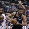 San Antonio Spurs\' Tim Duncan, right, gets a rebound against Los Angeles Clippers\' Antawn Jamison, left, and Willie Green during the first half of an NBA basketball game on Monday, Dec. 16, 2013, in Los Angeles. (AP Photo/Jae C. Hong)