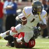 West Virginia\'s Tavon Austin is tackled by Texas Tech\'s D.J. Johnson during an NCAA college football game in Lubbock, Texas, Saturday, Oct. 13, 2012. (AP Photo/Lubbock Avalanche-Journal, Stephen Spillman) LOCAL TV OUT