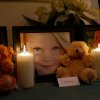 A candle is lit for Emilie Parker during a vigil in Pearland, Texas Friday, Dec. 21, 2012. (AP Photo/The Courier, Kirk Sides) ORG XMIT: TXCON108