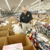 Volunteer Jerry Lojka, Midwest City Fire Marshal, loading bikes into a vehicle as parents and guardians pick up Angel Tree gifts at the Salvation Army Christmas Center in Midwest City Tuesday, Dec. 20, 2011. Photo by Paul B. Southerland, The Oklahoman ORG XMIT: KOD