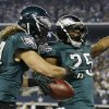 Photo - After scoring a touchdown against the Dallas Cowboys, Philadelphia Eagles running back LeSean McCoy (25) celebrates with Riley Cooper (14) during the first half of an NFL football game, Sunday, Dec. 29, 2013, in Arlington, Texas. (AP Photo/Tony Gutierrez)