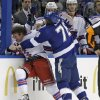 Photo - Tampa Bay Lightning left wing Pierre-Cedric Labrie (76) fights with New York Rangers right wing Derek Dorsett during the first period of an NHL hockey game Monday, Nov. 25, 2013, in Tampa, Fla. Both players received five-minute majors for fighting. (AP Photo/Chris O'Meara)