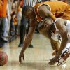 Oklahoma State\'s Markel Brown (22) dives for the ball beside Texas\' Jonathan Holmes (10) during an NCAA college basketball game between the Oklahoma State Cowboys (OSU) and the University of Texas Longhorns at Gallagher-Iba Arena in Stillwater, Okla., Wednesday, Jan. 8, 2014. Photo by Bryan Terry, The Oklahoman