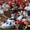 Oklahoma\'s DeMarco Murray (7) takes the ball up the middle through Air Force\'s Brady Amack (41), Zach Payne (51) and Rick Ricketts (90) during the first half of the college football game between the University of Oklahoma Sooners (OU) and the Air Force Falcons at the Gaylord Family - Memorial Stadium on Saturday, Sept. 18, 2010, in Norman, Okla. Photo by Chris Landsberger, The Oklahoman