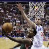 Milwaukee Bucks\' Brandon Jennings, left, goes up for a shot past Philadelphia 76ers\' Spencer Hawes in the first half of an NBA basketball game, Monday, Nov. 12, 2012, in Philadelphia. (AP Photo/Matt Slocum)