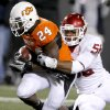 Oklahoma\'s Ronnell Lewis (56) brings down Oklahoma State\'s Kendall Hunter (24) during the Bedlam college football game between the University of Oklahoma Sooners (OU) and the Oklahoma State University Cowboys (OSU) at Boone Pickens Stadium in Stillwater, Okla., Saturday, Nov. 27, 2010. Photo by Bryan Terry, The Oklahoman