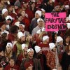A fan in the OU student section holds a sign that reads