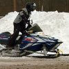 Photo - A snowmobiler heads for a trail after getting fuel at a gas station on Main Street in Forest City, Pa., on Wednesday, Feb. 5, 2014, after a winter snow storm. (AP Photo/The Scranton Times-Tribune, Butch Comegys) WILKES BARRE TIMES-LEADER OUT; MANDATORY CREDIT.