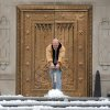 Tim Hensley works to get the ice off of the steps of the Indiana War Memorial Friday, Feb. 22, 2013 in Indianapolis. A snowstorm left behind varying amounts of snow and ice across the Midwest causing difficult travel conditions. (AP Photo/The Indianapolis Star, Matt Kryger) NO SALES