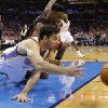 Oklahoma City\'s Nick Collison (4) dives for the ball in front of Miami\'s Norris Cole (30) during an NBA basketball game between the Oklahoma City Thunder and the Miami Heat at Chesapeake Energy Arena in Oklahoma City, Thursday, Feb. 20, 2014. Photo by Bryan Terry, The Oklahoman