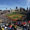 In this photo taken with a fisheye lens, baseball fans at in PNC Park watch the season opening baseball game between the Pittsburgh Pirates and the Chicago Cubs in Pittsburgh, Monday, March 31, 2014. The Pirates won 1-0 in ten innings.(AP Photo/Gene J. Puskar)