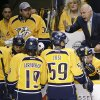 Photo - Nashville Predators coach Barry Trotz talks with his players during a timeout during the first period of an NHL hockey game against the Chicago Blackhawks on Saturday, April 12, 2014, in Nashville, Tenn. (AP Photo/Mark Humphrey)