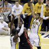 Miami Heat\'s Dwyane Wade (3) goes makes a pass against Indiana Pacers\' Roy Hibbert (55) and Paul George during the second half of Game 3 of the NBA Eastern Conference basketball finals in Indianapolis, Sunday, May 26, 2013. (AP Photo/Michael Conroy)