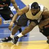 Oklahoma City Thunder\'s James Harden, left, scrambles for a loose ball against P.J. Tucker of the Charlotte Bobcats during the second half of an NBA summer league basketball game in Orlando, Fla., Tuesday, July 6, 2010.(AP Photo/John Raoux) ORG XMIT: FLJR114