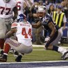 New York Giants running back Ahmad Bradshaw (44) scores on a touchdown in front of New England Patriots linebacker Jerod Mayo, right, during the second half of the NFL Super Bowl XLVI football game, Sunday, Feb. 5, 2012, in Indianapolis. (AP Photo/Matt Slocum) ORG XMIT: SB470