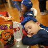 Too much partying made this student take a nap at the table. Midwest City parks and recreation department hosted a trick or treat Halloween party for special needs children in the Nick Harroz Community Center Thursday afternoon, Oct. 31, 2013. A parks spokesperson said about 150 children, wearing costumes, attended the event. The children are students at local elementary schools. Students from Carl Albert Middle School Key Club volunteered at the carnival booths and they handed out candy and treats to the children as they entered the building. Photo by Jim Beckel, The Oklahoman.