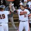 OKLAHOMA STATE UNIVERSITY / OSU / CELEBRATION: Oklahoma State\'s Aaron Cornell, left, celebrates with Victor Romero after scoring in the first inning of OSU\'s college baseball game against Alcorn State in Stillwater, Okla., Tuesday, Feb. 19, 2013. Photo by Bryan Terry, The Oklahoman